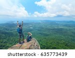 man and woman standing on cliff'...   Shutterstock . vector #635773439