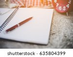 Open Notebook With Pen And Red...