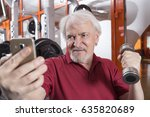 elderly man taking a selfie... | Shutterstock . vector #635820689
