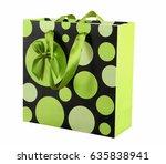 green paper shopping bags on a...   Shutterstock . vector #635838941