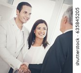 Small photo of Young Married Couple With Their Financial Advisor