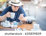 young asian man with a cup of... | Shutterstock . vector #635859839