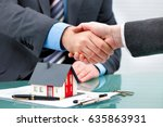 estate agent shaking hands with ... | Shutterstock . vector #635863931