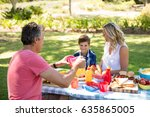 happy family interacting with... | Shutterstock . vector #635865005