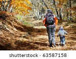 Father And Son Walking In...