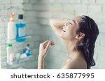 asian women are taking a shower ... | Shutterstock . vector #635877995