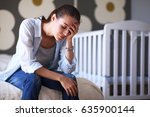 young tired woman sitting on... | Shutterstock . vector #635900144