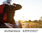 motorcycle driver drink water... | Shutterstock . vector #635915327
