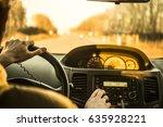 man's hand driving a car at... | Shutterstock . vector #635928221
