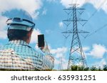 Small photo of Engineers use mobile phones with high voltage towers as backgrounds. The concept of using image overlapping techniques. The idea of an electrical engineer. Double exposure. Selective focus.