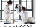experienced male orthopedist... | Shutterstock . vector #636023411