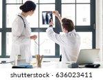 experienced male orthopedist...   Shutterstock . vector #636023411