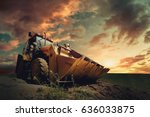 yellow tractor on sky background | Shutterstock . vector #636033875