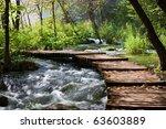 Wooden Footbridge Across Stream ...
