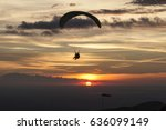 paragliding at sunset | Shutterstock . vector #636099149