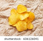 chips on paper background | Shutterstock . vector #636126041