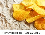 chips on paper background | Shutterstock . vector #636126059