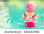 baby sitting near swimming pool. | Shutterstock . vector #636162581