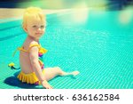baby sitting near swimming pool. | Shutterstock . vector #636162584