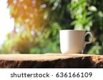 white cup coffee on nature ... | Shutterstock . vector #636166109