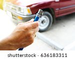 a man checking air pressure and ... | Shutterstock . vector #636183311