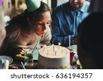 Woman Blowing Candles On Cake...