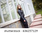 pretty woman walking in park.... | Shutterstock . vector #636257129
