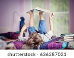 little boy lying on bed playing ... | Shutterstock . vector #636287021