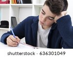 child writing and studying at... | Shutterstock . vector #636301049
