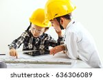 two small kid boys with yellow... | Shutterstock . vector #636306089
