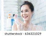 asian women are taking a shower ... | Shutterstock . vector #636321029