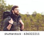handsome  bearded guy hiking in ... | Shutterstock . vector #636322211