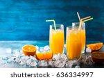 fresh orange juice in glasses ... | Shutterstock . vector #636334997