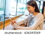 woman use of mobile phone in... | Shutterstock . vector #636345569
