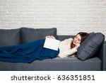 tired young woman taking a nap... | Shutterstock . vector #636351851