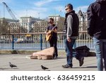 Small photo of LONDON, UK - APRIL 22, 2017: Shoreditch, London: street musicians at Columbia Road flower market . Street artists animate giving emotions to big cities