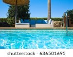lounge chairs near pool side | Shutterstock . vector #636501695