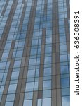 Small photo of Glass window building exterior. Generic unrecognizable modern office or apartment building. Vertical frame establishing shot.