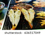 big shrimps cut in the middle... | Shutterstock . vector #636517049