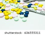 drug tablets and scalpel... | Shutterstock . vector #636555311