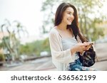 asia woman walking and using a... | Shutterstock . vector #636562199