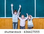 joyful schoolchildren in class... | Shutterstock . vector #636627055