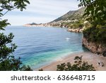 Small photo of Waves lap up against the shores of Sveti Jakov, a secluded beach sandwiched between the rocks facing the town of Dubrovnik.