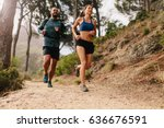 fit young couple running on... | Shutterstock . vector #636676591