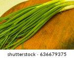 fresh green onions on a cutting ...   Shutterstock . vector #636679375