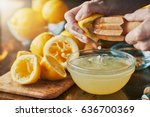 squeezing fresh lemon juice... | Shutterstock . vector #636700369
