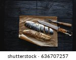 Stock photo herring fillet marinated spices rustic fork and knife on a black wooden table view from above 636707257