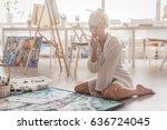 beautiful young woman sitting...   Shutterstock . vector #636724045