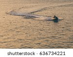 A Man Riding A Jetboat During...