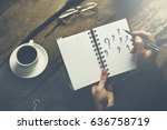 woman writing question mark on... | Shutterstock . vector #636758719